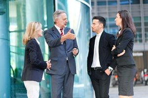communication - group of business people having a conversation