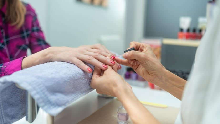 Woman pampering herself with a manicure